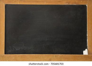 Empty blackboard with chalk. Back to school.