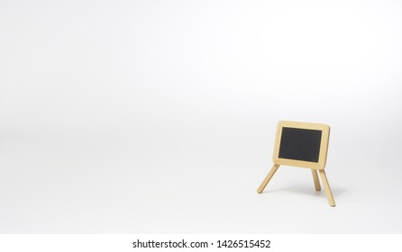 Empty blackboard isolated in a white void. With copy space text. Studio Shot. Grey background.