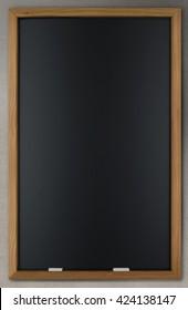 An empty blackboard on a concrete wall