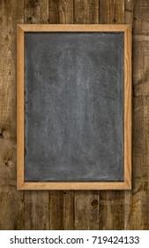 Empty blackboard on rustic wooden background