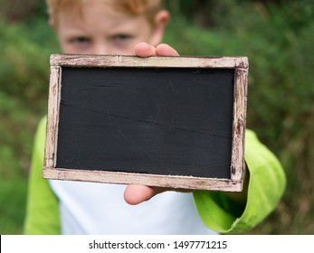 Empty Blackboard On Wooden Canvas as Background for Your Message