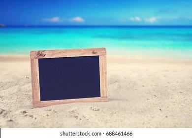 empty blackboard at the summer beach