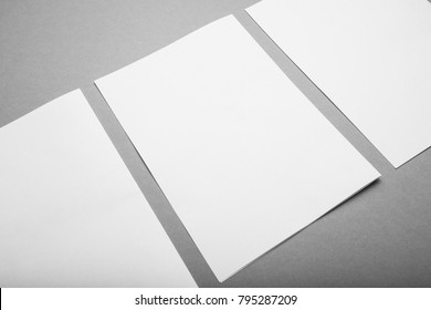 Empty blank A4, brochure magazine isolated on gray, white paper isolated on gray.