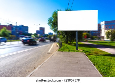 Empty blank billboard at busy road, mock up