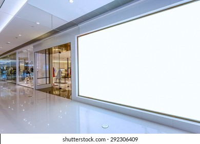 Empty blank billboard in shopping mall interior