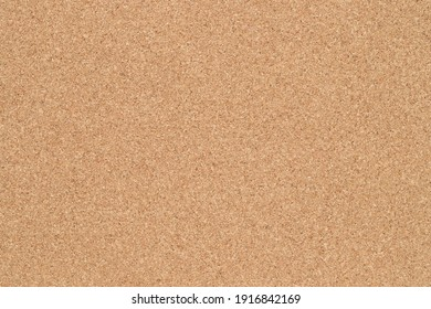 Empty blank cork board or bulletin board. Close up of corkboard texture