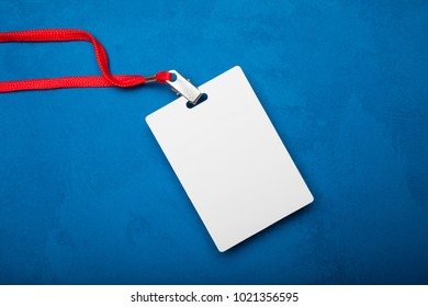 Empty Blank ID card tag isolated on blue background. Mockup.
