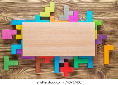 Empty, blank rectangle wooden board on colourful background. Chalkboard on colorful background from wooden puzzle blocks.