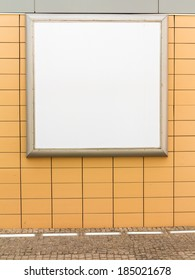 Empty blank square white advertising billboard on orange tiled wall. Information. Promotion of your product. Real.