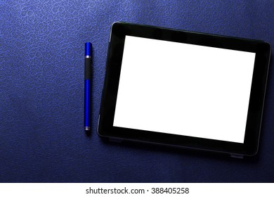 Empty / blank tablet with blue pen on blue pattern textured background