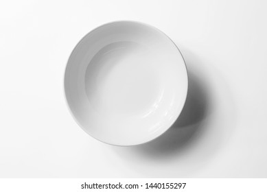 Empty blank white ceramic round bowl isolated on white background with shadow.
