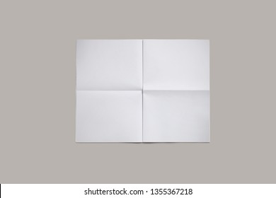 Empty blank, white expanded newspaper, Mock Up, front page, isolated on grey background.