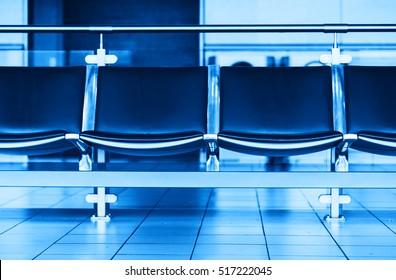 Empty blue airport seats bench bokeh background hd