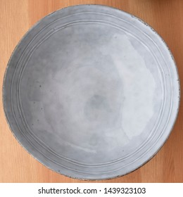 Empty blue bowl on wooden surface, image on of 8