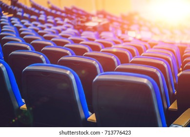 Empty blue chairs at cinema or theater or a conference room.