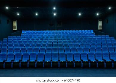Empty blue cinema seats, chairs.