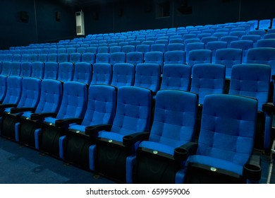 Empty blue cinema seats, chairs. Perspective view