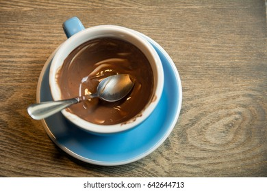 Empty blue Cups of hot Chocolate drink on wooden background. Morning time. Holiday concept, Selective focus