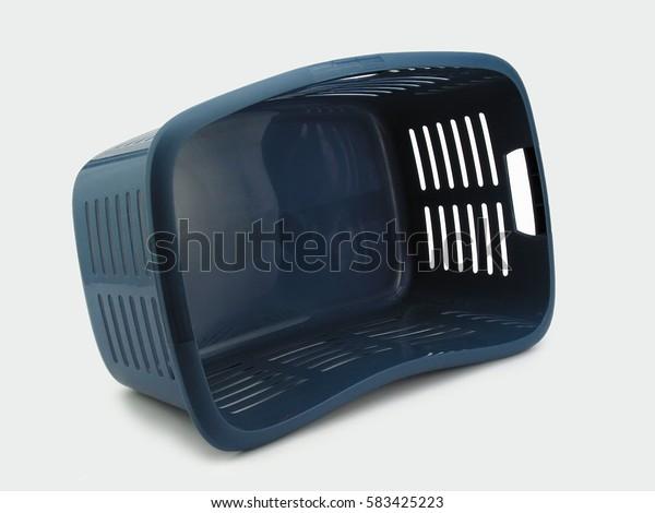 Empty blue laundry basket isolated on white bakground