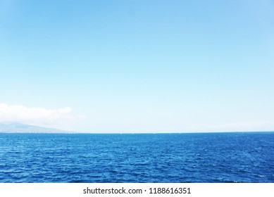 Empty Blue Ocean and Blue Sky