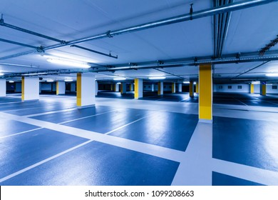 Empty blue parking Garage with yellow columns