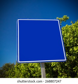 Empty blue road sign. Tropical street, mock up, space for text