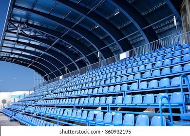 empty blue seat at abstract stadium