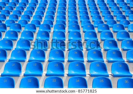 Empty blue seats in a stadium