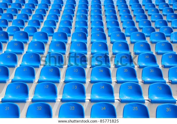 Empty blue seats in a stadium