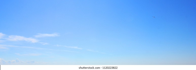 Empty Blue Sky Background, Simple Natural Texture Template of Sky with Small Clouds. Backdrop of Pale Light Blue Color, Blur Sky Texture, Blank Wallpaper Poster for Copy Space.
