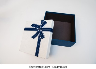 Empty blue and white gift packaging on a white background.