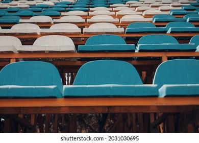 Empty blue white stadium seats, empty bleachers