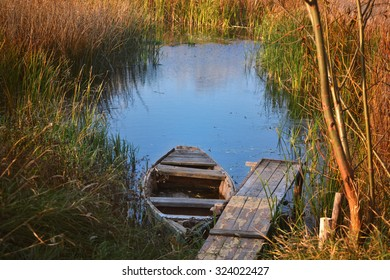 An empty boat on the lake at the Marina. Autumn landscape.
