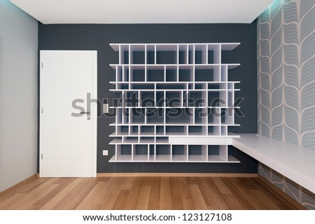 Empty Bookshelf On The Wall With Door