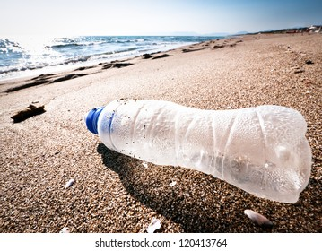 empty bottle at a beach in italy