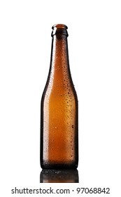 Empty bottle of beer with drops isolated on white background.