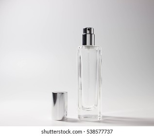 empty bottle of perfume on a light background