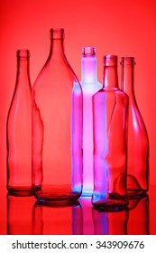 Empty bottles isolated over the red background