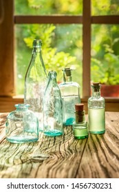 Empty bottles of tinctures on a rustic table