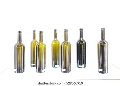 Empty bottles of wine on a white background aligned
