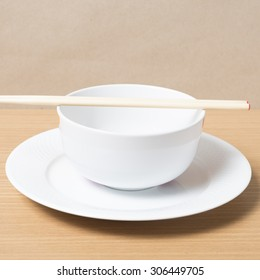 empty bowl with chopstick on wood table background