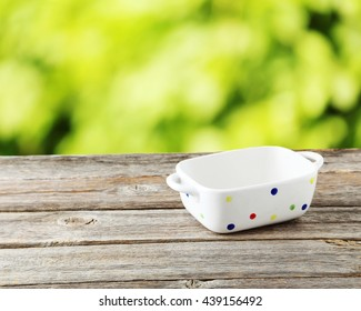 Empty bowl on grey wooden background