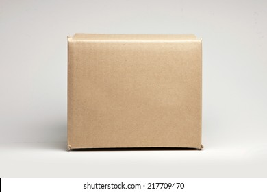 a empty box front view isolated white.