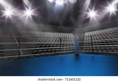 Empty boxing ring in arena, spot lights, smoke and dark night scene. Dramatic fighters background, extreme sport and exhibition.