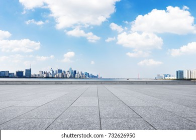empty brick floor and cityscape of hangzhou qianjiang new city in blue cloud sky