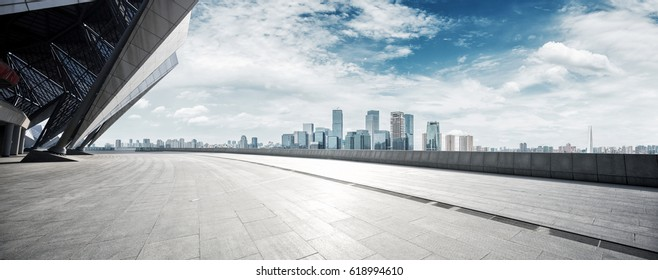 empty brick floor with cityscape of modern city