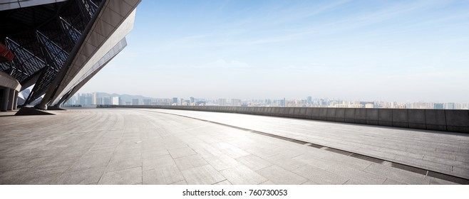 empty brick floor and cityscape of shaoxing in blue foggy sky