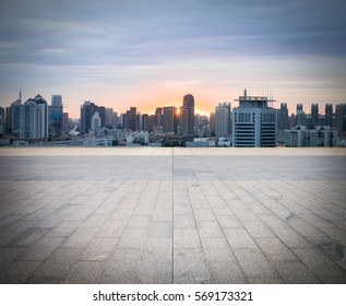empty brick floor with cityscape and skyline, tianjin in sunset