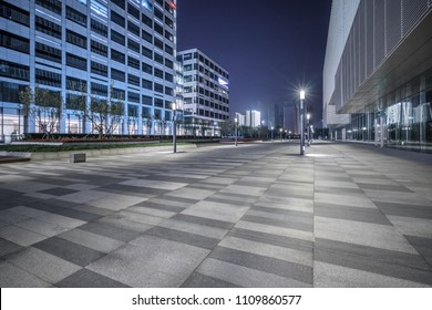 empty brick road nearby office building, china