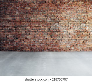 Empty Brick Wall with Concrete Floor